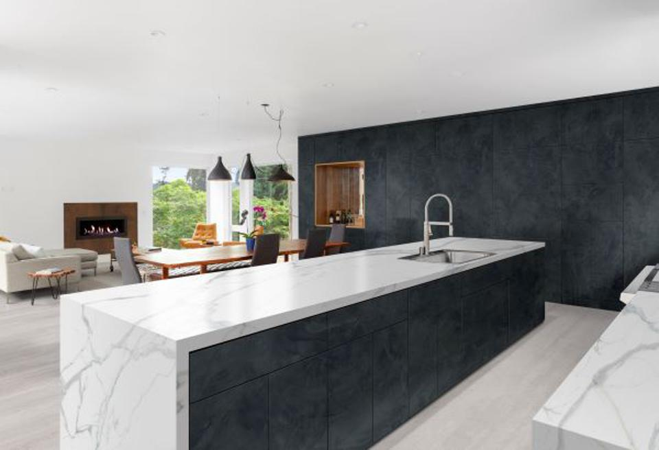 Kitchen with porcelain wall, cabinet front, countertop and floors in the latest trends.