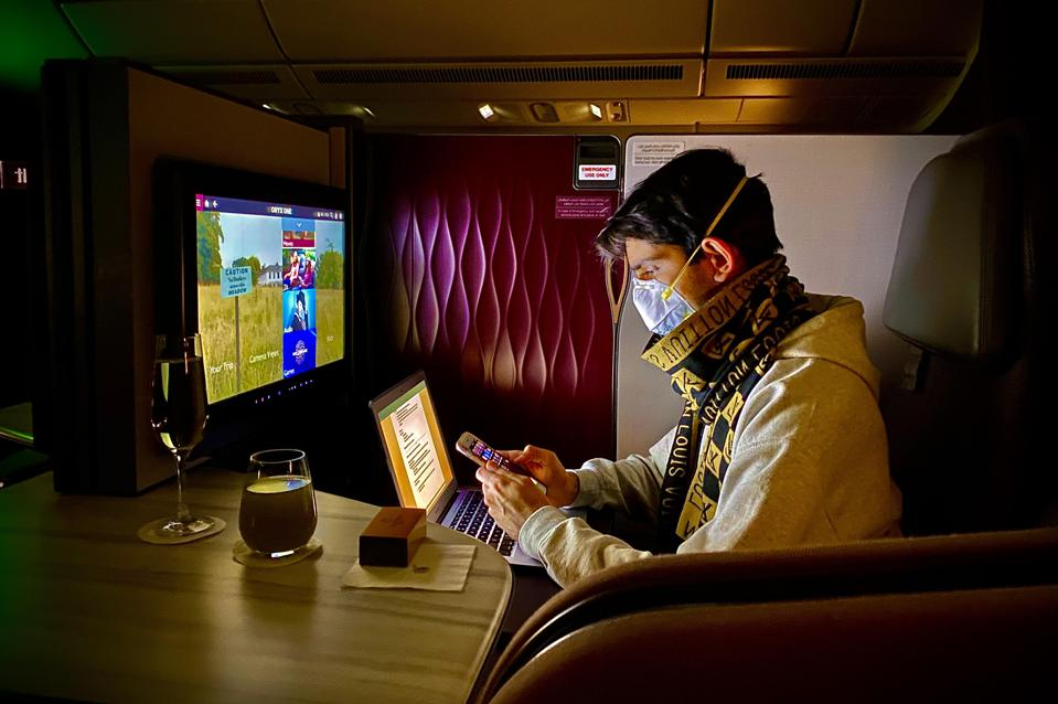 young boy traveling for business on luxury airline during the pandemic coronavirus