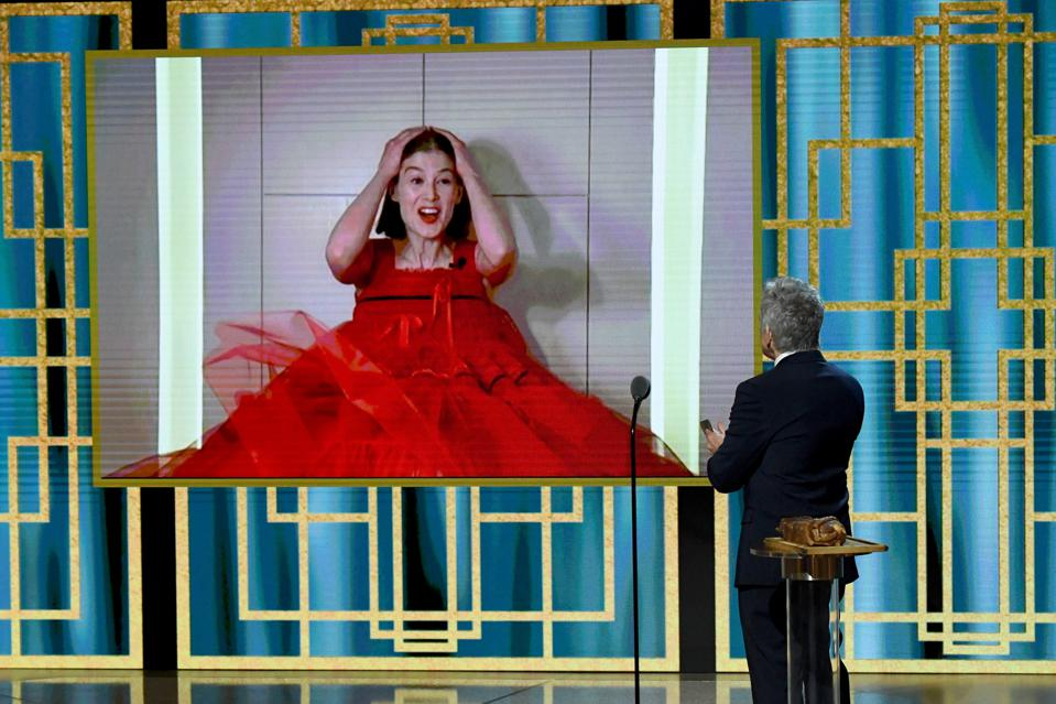 Rosamund Pike, Lumenate creative director, exhibits surprise as learns she is the winner of the Best Actress - Motion Picture – Musical/Comedy award via livestream with Ben Stiller during the 78th Annual Golden Globe Awards.