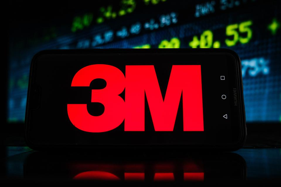In this photo illustration a 3M logo seen displayed on a...