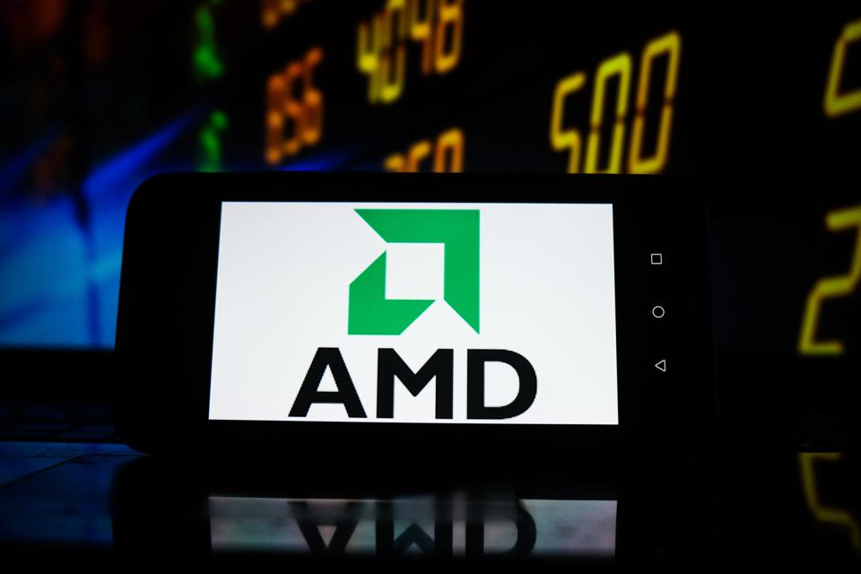 In this photo illustration an AMD logo seen displayed on a...