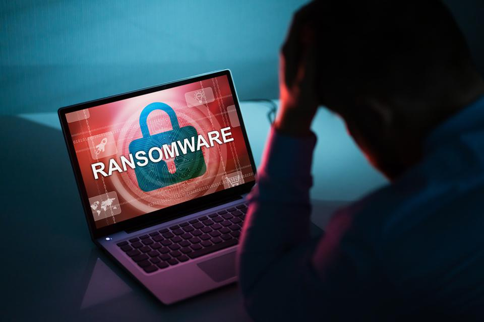 Person Looking At Laptop Screen with ransomware