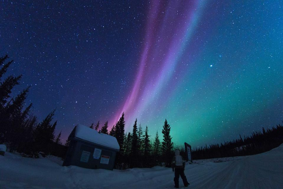 View of aurora borealis storm during midnight in Yellowknife...