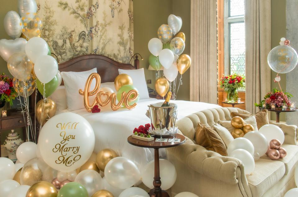 A bedroom at Adare Manor in Ireland with balloons.