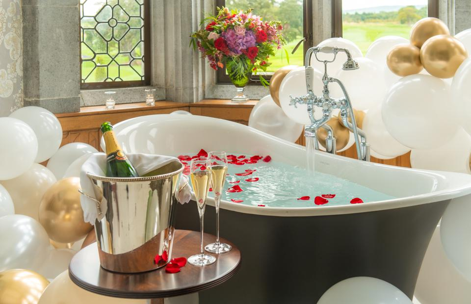 A luxurious bathtub with rose petals at Adare Manor.