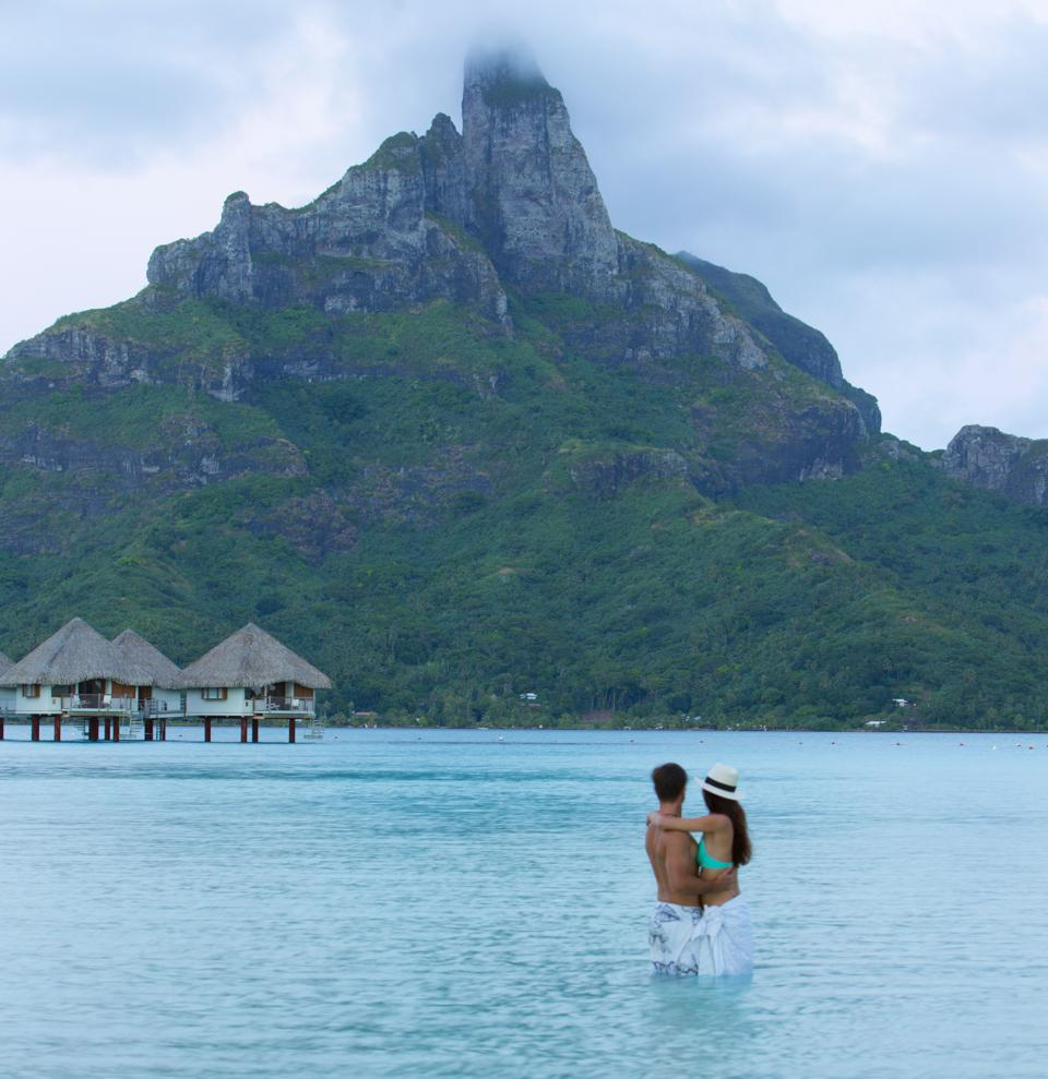 A couple embracing in the water at Mount Pahia.