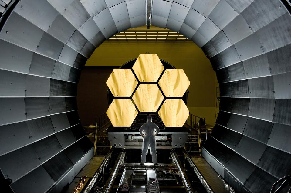 NASA engineer Ernie Wright looks on as the first six flight ready James Webb Space Telescope's primary mirror segments are prepped to begin final cryogenic testing at NASA's Marshall Space Flight Center. This represents the first six of 18 segments that will form NASA's James Webb Space Telescope's primary mirror for space observations.