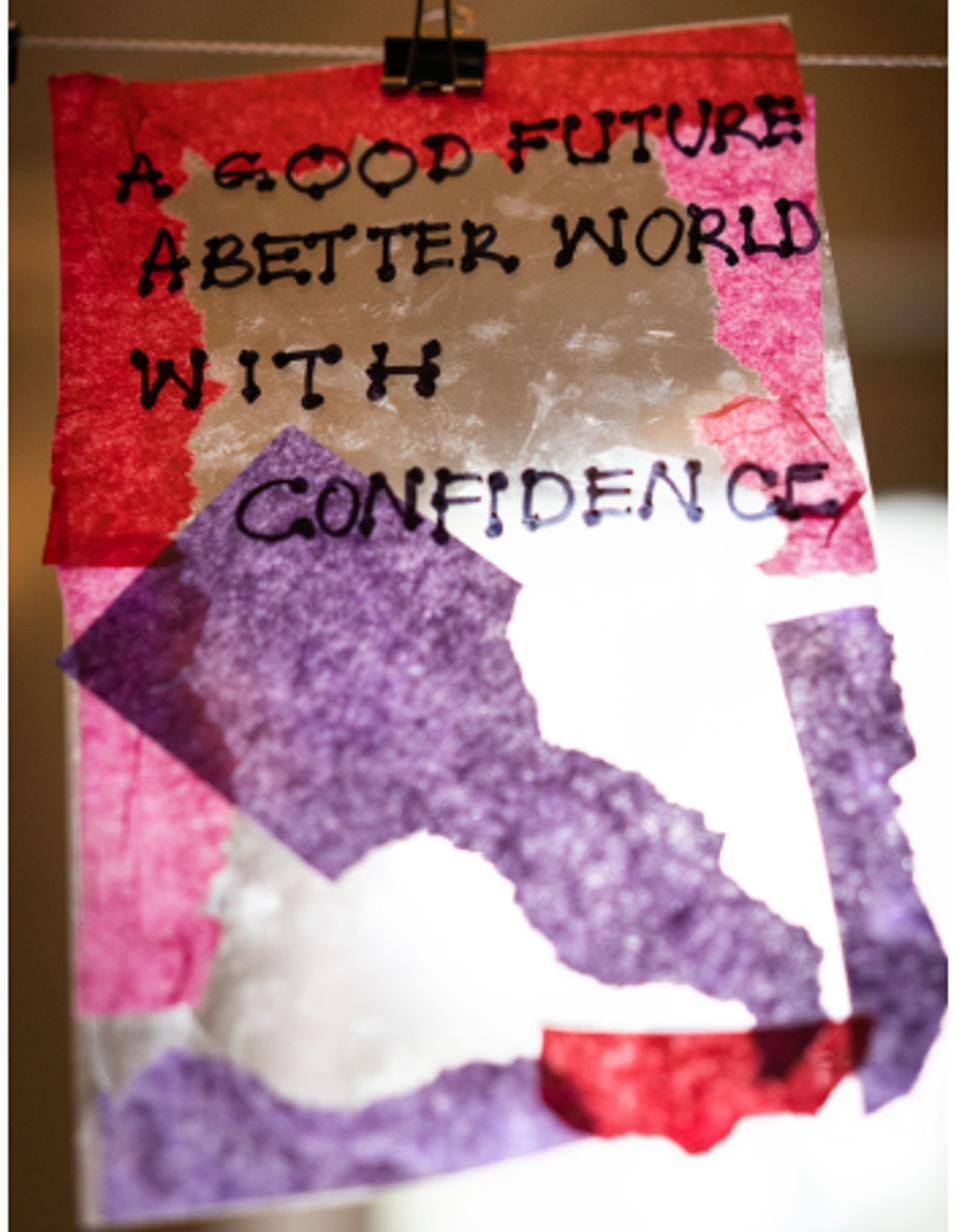 Artwork that reads, ″A Good Future, A Better World, With Confidence.″