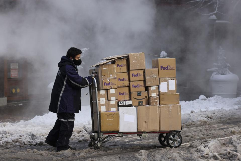 Fedex boxes on a cart in snow