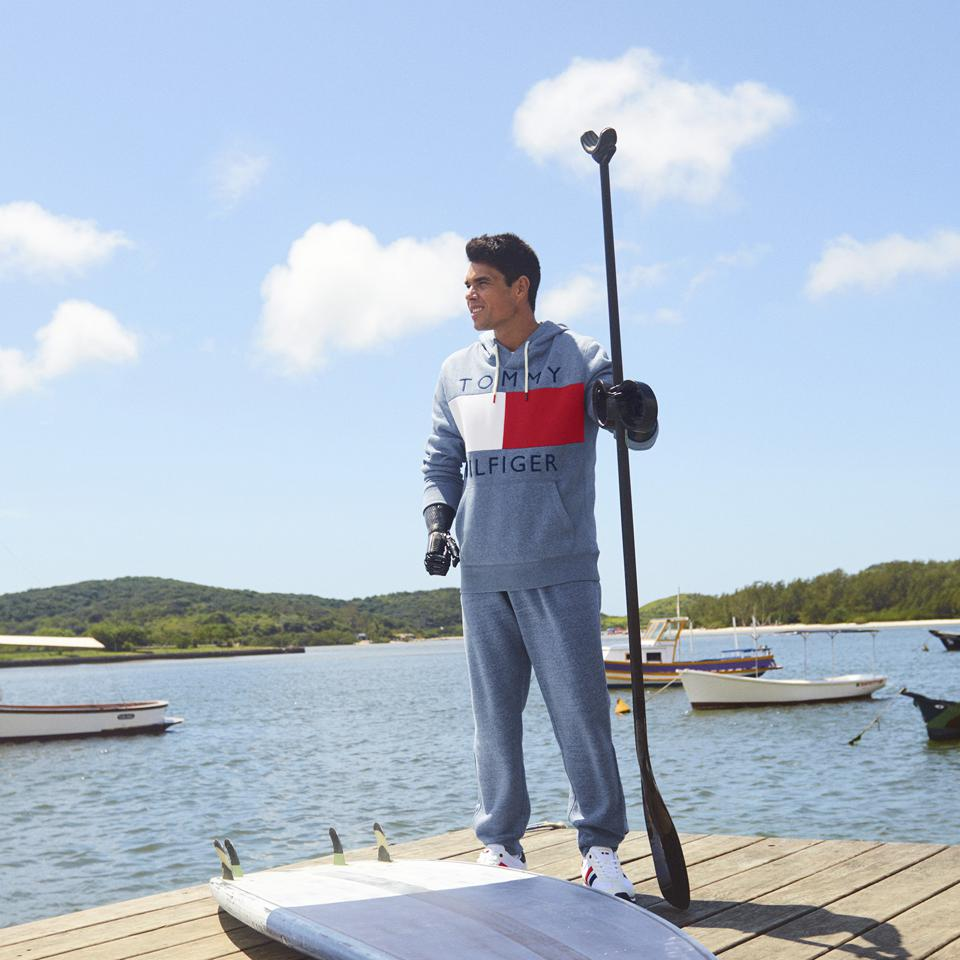 Image of paddle boarder wearing Tommy Hilfiger Adaptive gear