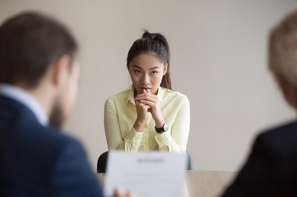 Nervous Asian applicant stressed at job interview
