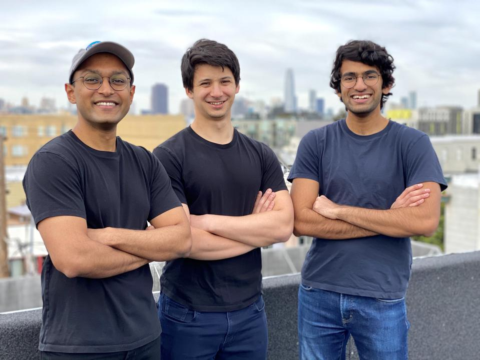 Hightouch cofounders wearing black shirts, cityscape background against a gray wall.