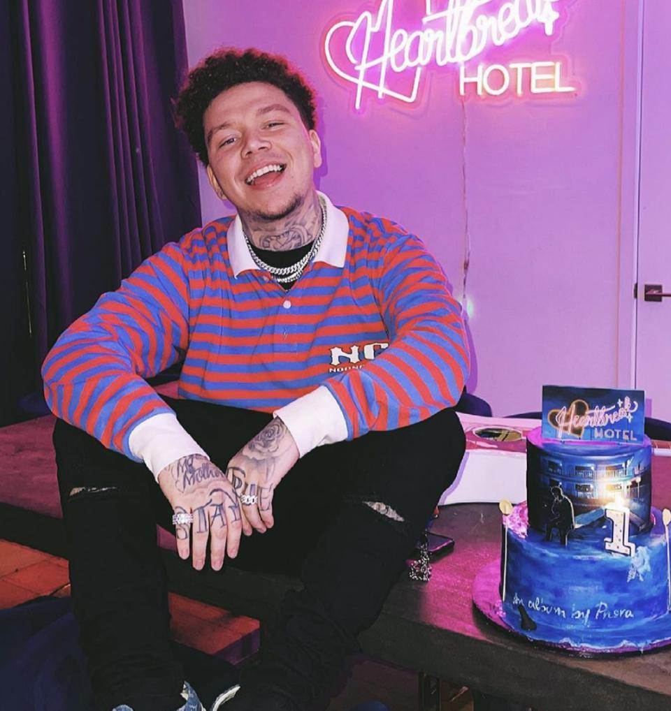 Phora poses with a cake for his latest album, Heartbreak Hotel.