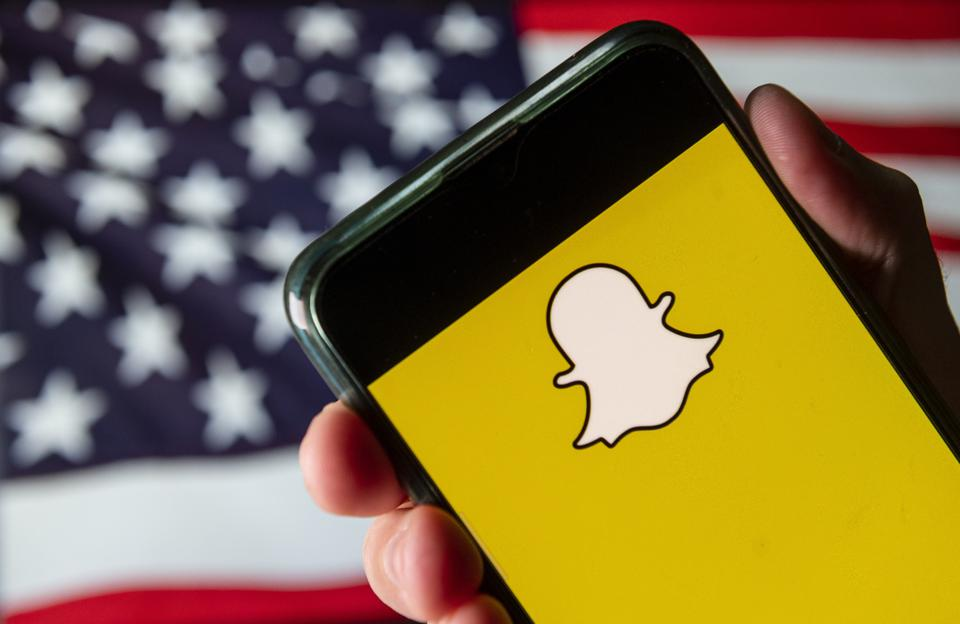 In this photo illustration the multimedia messaging SnapChat...