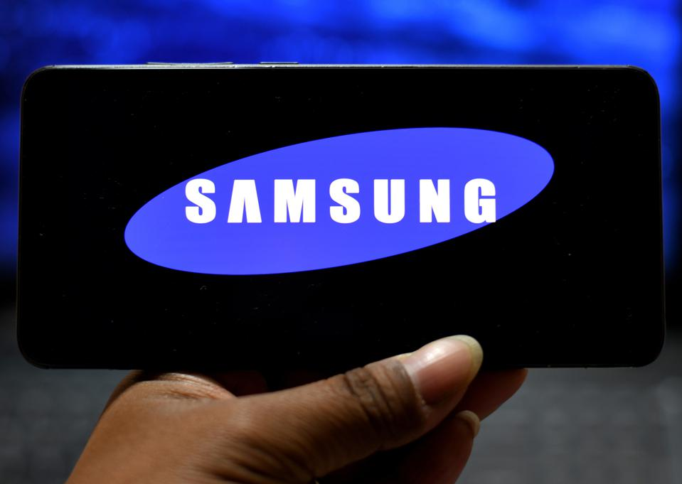 In this photo illustration a Samsung  logo seen displayed on...