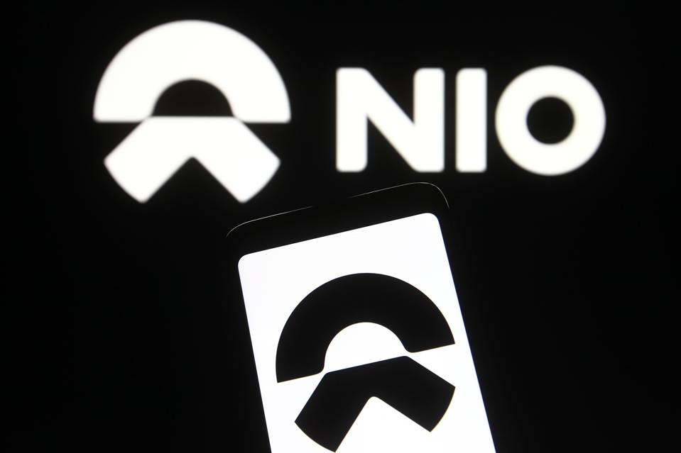 In this photo illustration a NIO logo of a Chinese car...