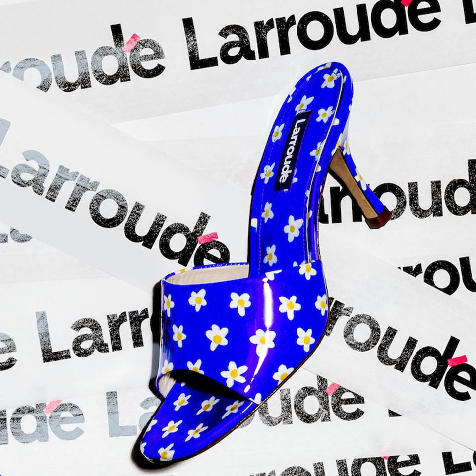 A royal blue  and floral pattern Larroudé slide created exclusively for Colette Paris recent online pop-up.