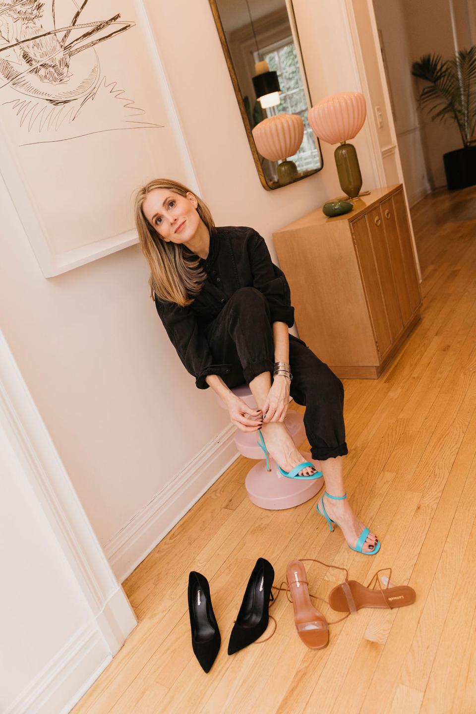 Larroudé founder Marina Larroude trying on samples of her shoe collection.