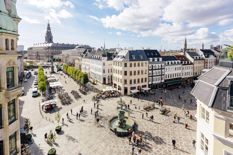 Aerial view of Copenhagen skyline and Amagertorv town square with fountain, Denmark