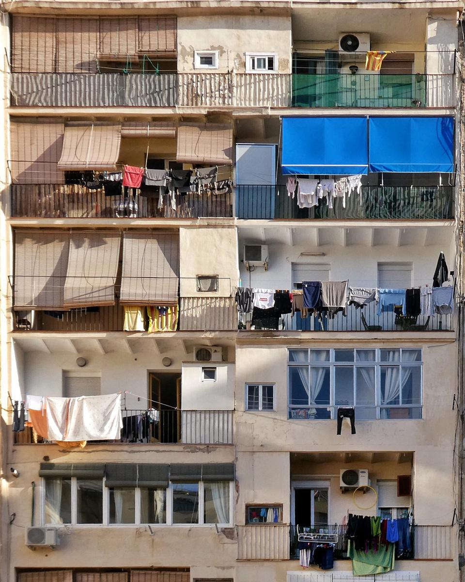 Interior facade of a residential block in Eixample Barcelona with laundry drying.