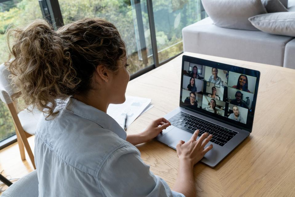 Woman in a video conference with her coworkers while working from home