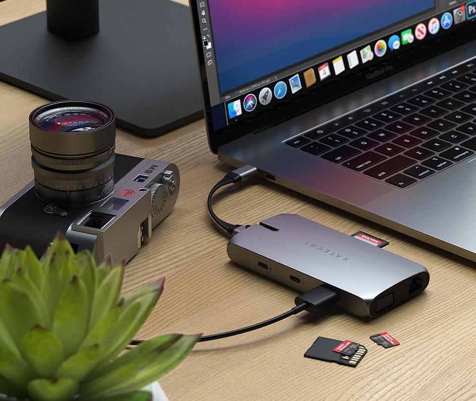 Satechi On-the-Go Multiport adapter next to a laptop