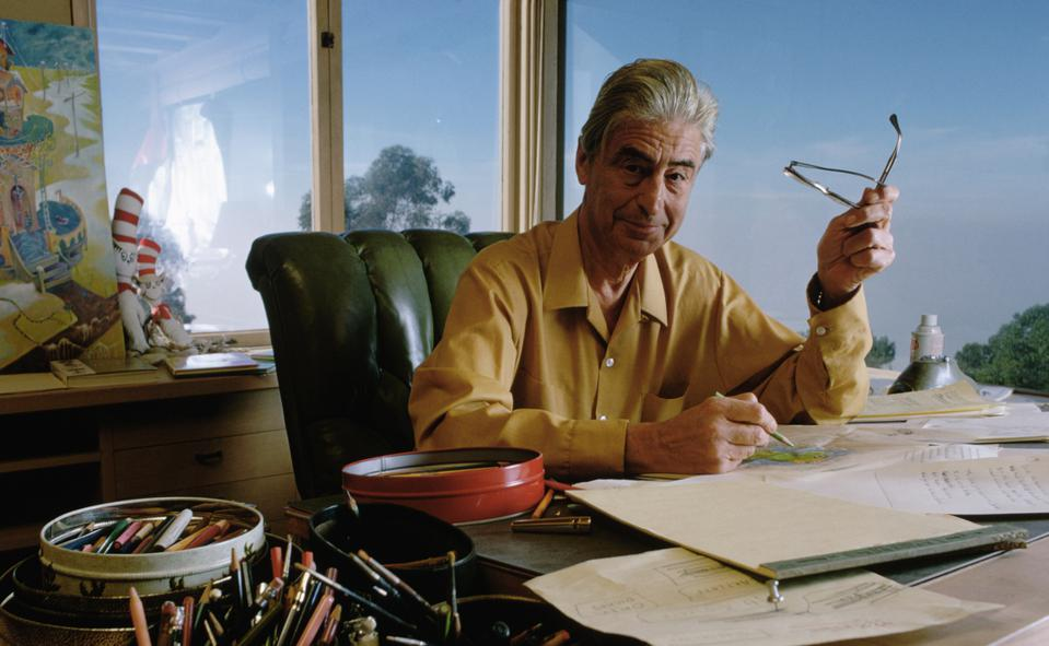 Dr. Seuss Drawing at His Desk
