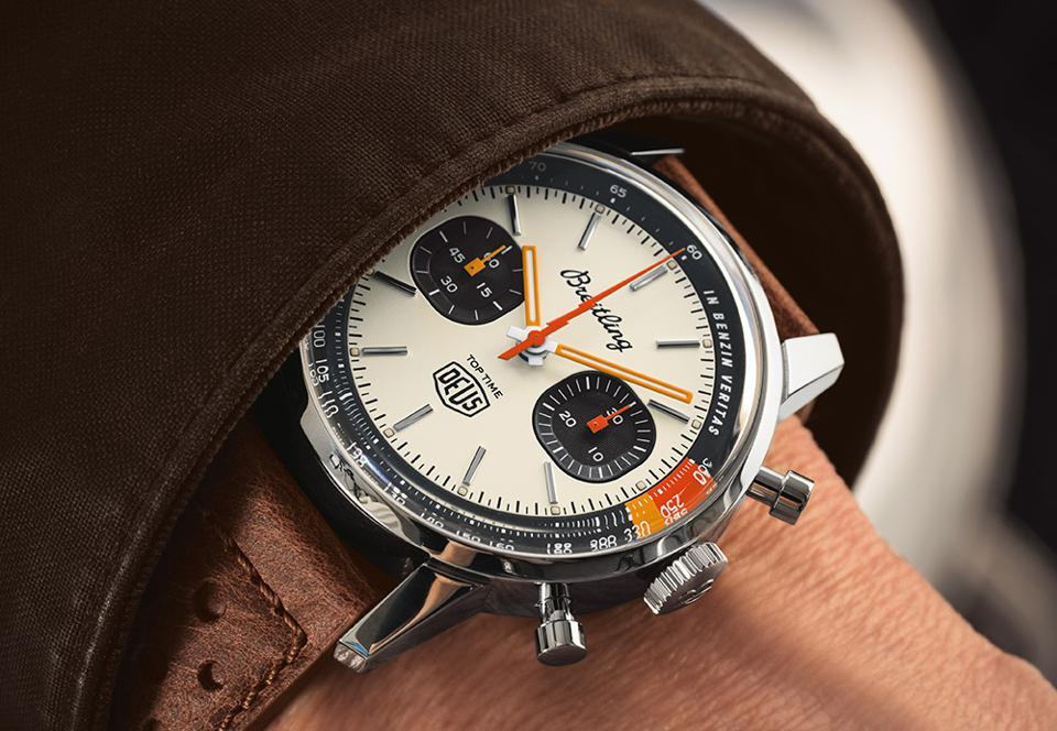 """The phrase """"IN BENZIN VERTAS"""" is printed along the tachymeter scale. It translates to """"In petrol we trust."""""""