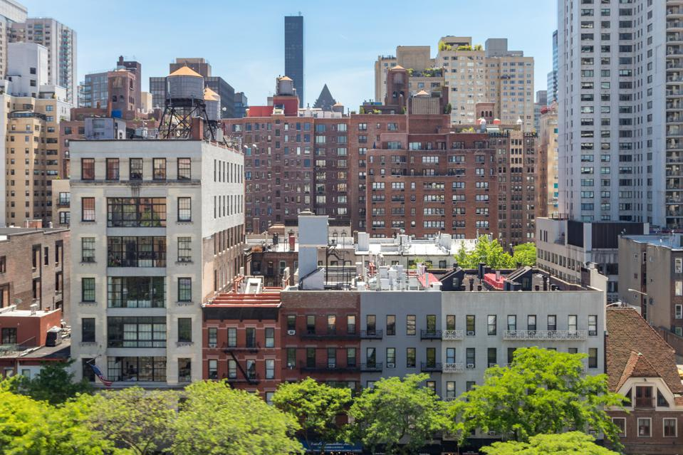New York City - Overhead view of historic buildings along 59th Street with the Midtown Manhattan skyline in the background