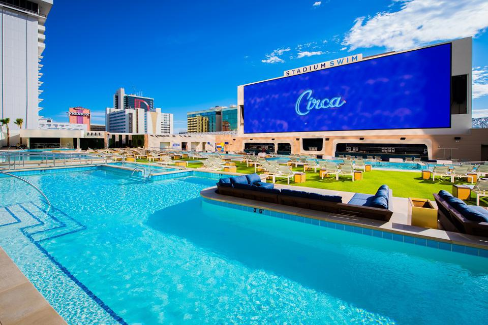 Pool complex on roof of Circa casino resort Las Vegas with giant TV screen