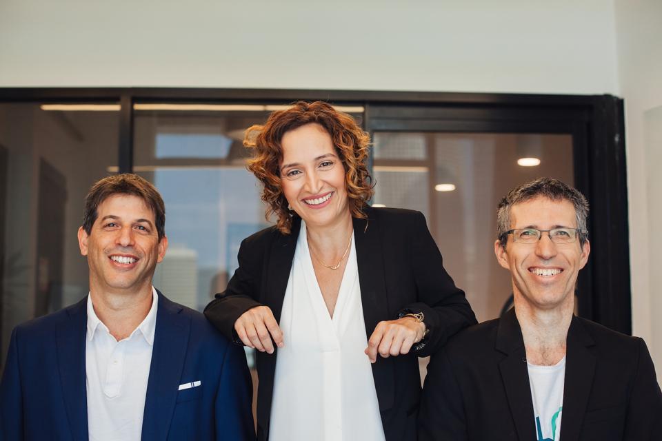 Three founders of Papaya Global all facing the camera.