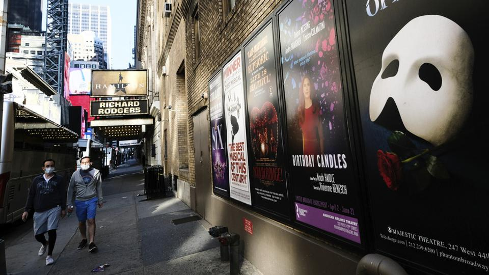 Broadway posters outside of Hamilton theater