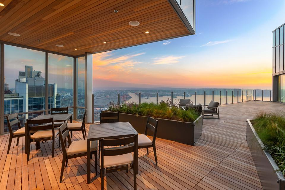 A beautiful teak terrace overlooks the water and surrounding cityscape.