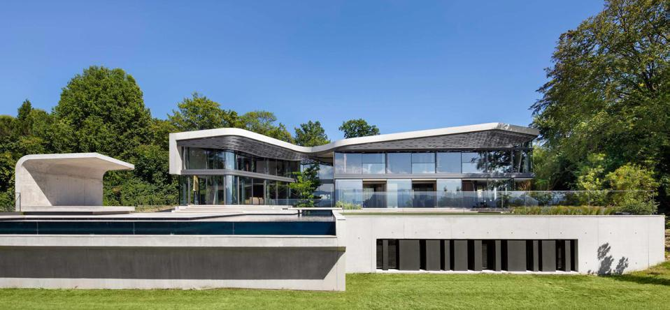 swimming pool and house villa courbe saota designed switzerland cologny house