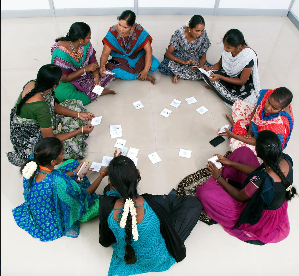 Workers participate in a  group training activity as part of Empower@Work