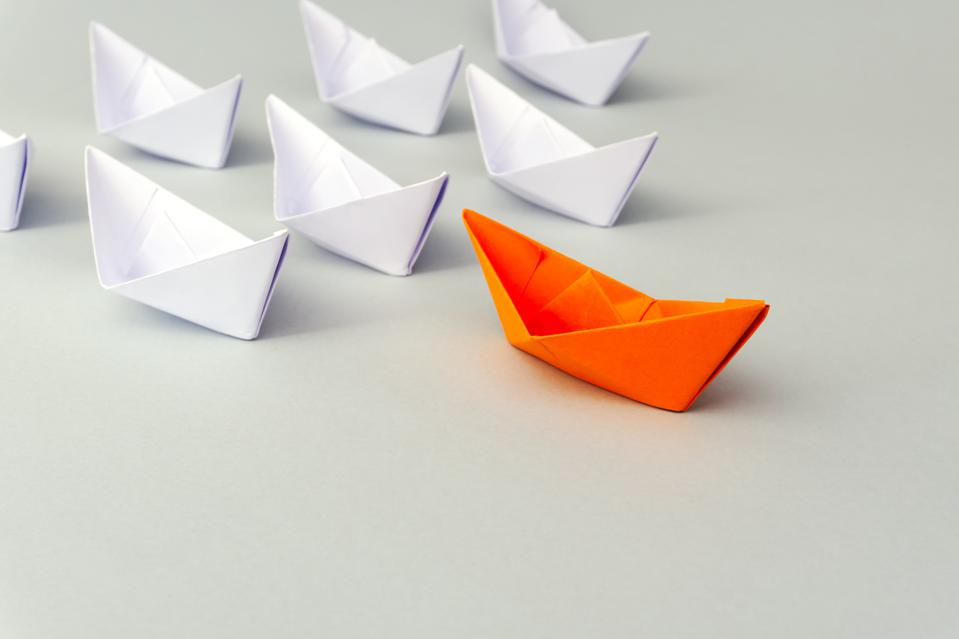 Paper Boat Business Leadership Concept