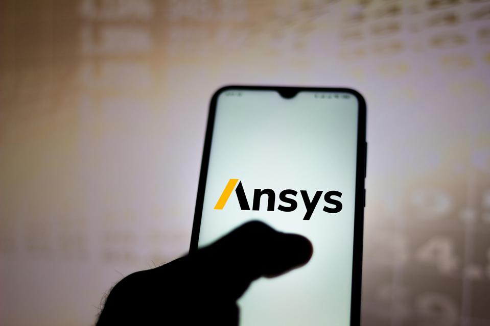 In this photo illustration the Ansys logo seen displayed on...