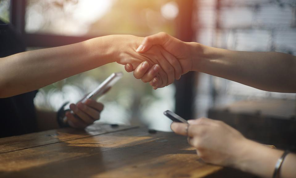 close up business female shaking hand for accept deal at cafe