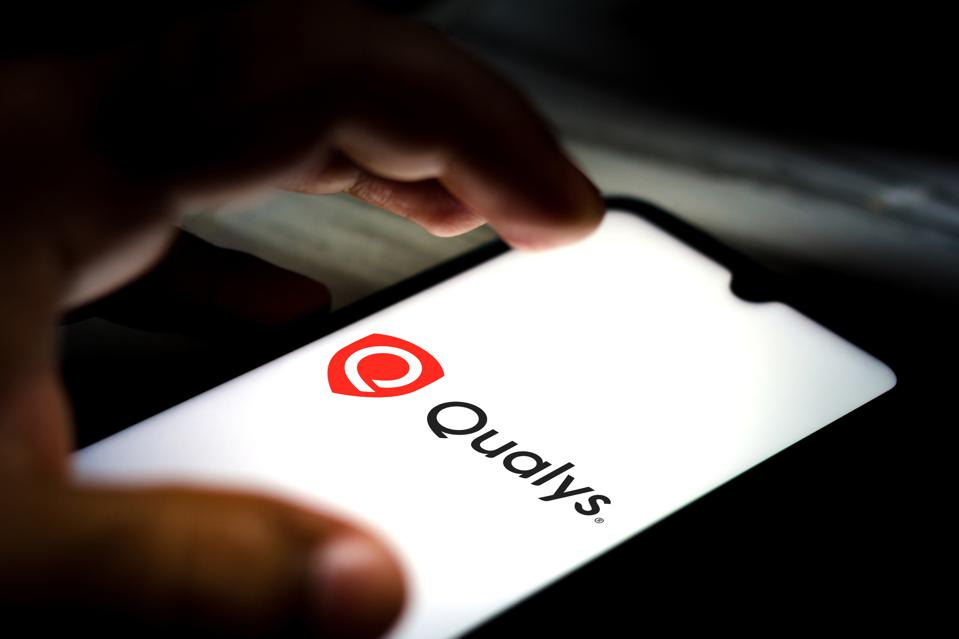 In this photo illustration the Qualys logo seen displayed on...