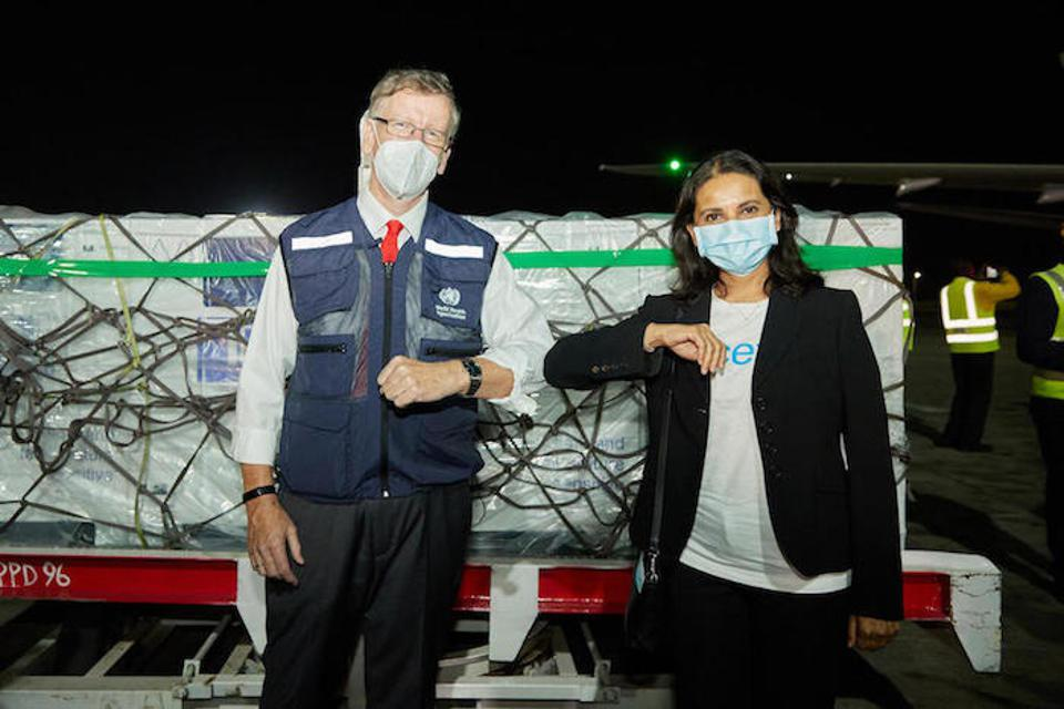 WHO Kenya Representative Rudi Eggers, left, and UNICEF Kenya Representative Maniza Zaman meet on the tarmac at Jomo Kenyatta International Airport in Nairobi, Kenya on March 3 to receive the country's first COVID-19 vaccines from the COVAX facility.