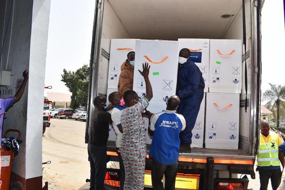 Workers load COVID-19 vaccine doses onto a truck at Nnamdi Azikiwe International Airport in Abuja, Nigeria on March 2.