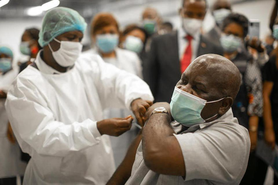 Dr. Luzola Messo, a senior frontline health professional, receives the COVID-19 vaccine.