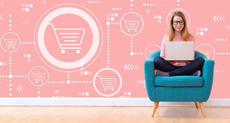 Online shopping theme with woman using a laptop