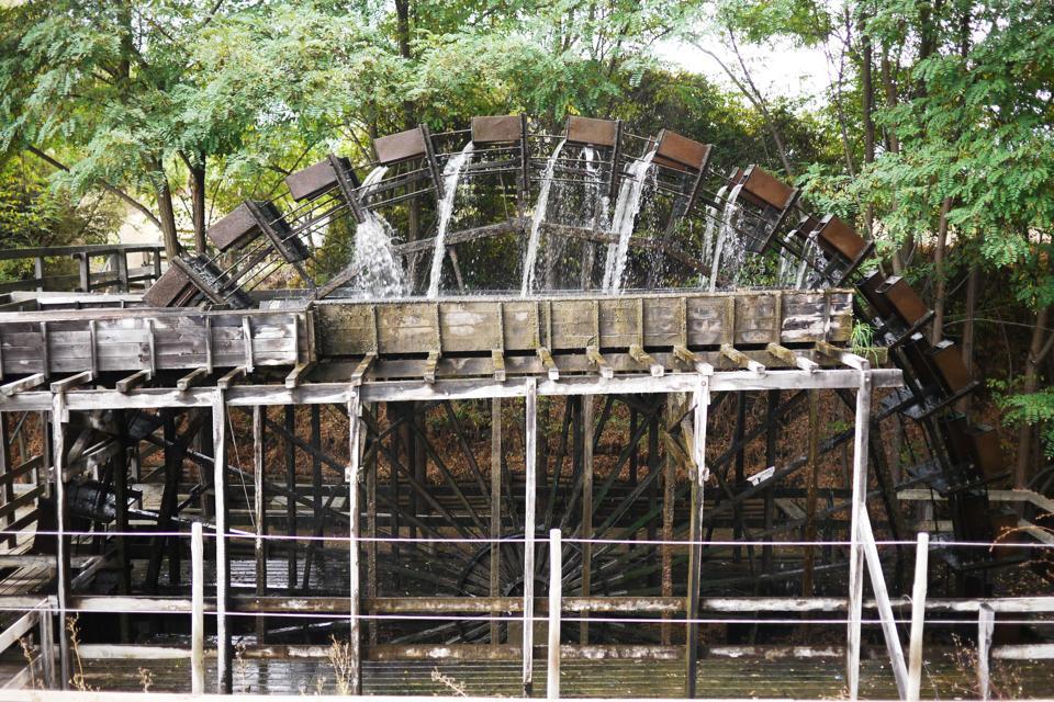 Wooden wheel spinning water
