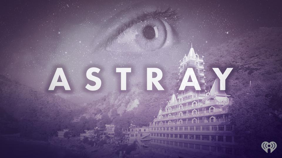 A giant eye overlooking a building with the word ″astray″