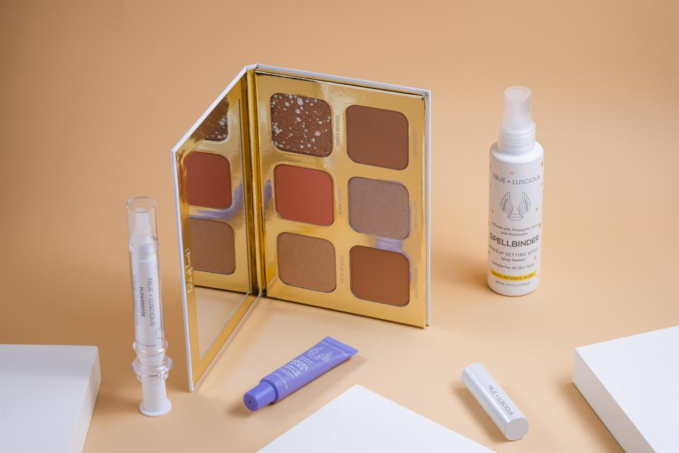 True + Luscious makeup displayed on a beige background.