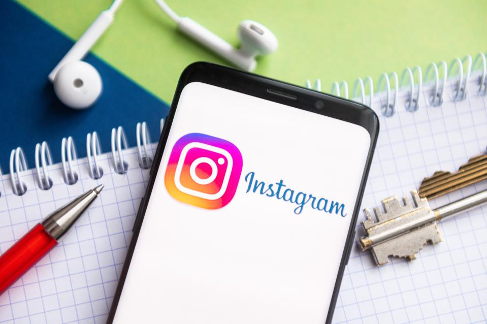 In this photo illustration, an Instagram logo seen displayed...