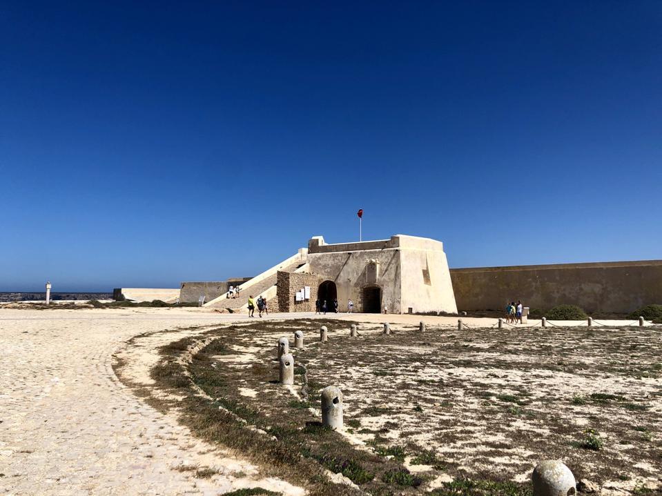 Fortaleza de Sagres in southwest Portugal stands beneath a bright blue sky