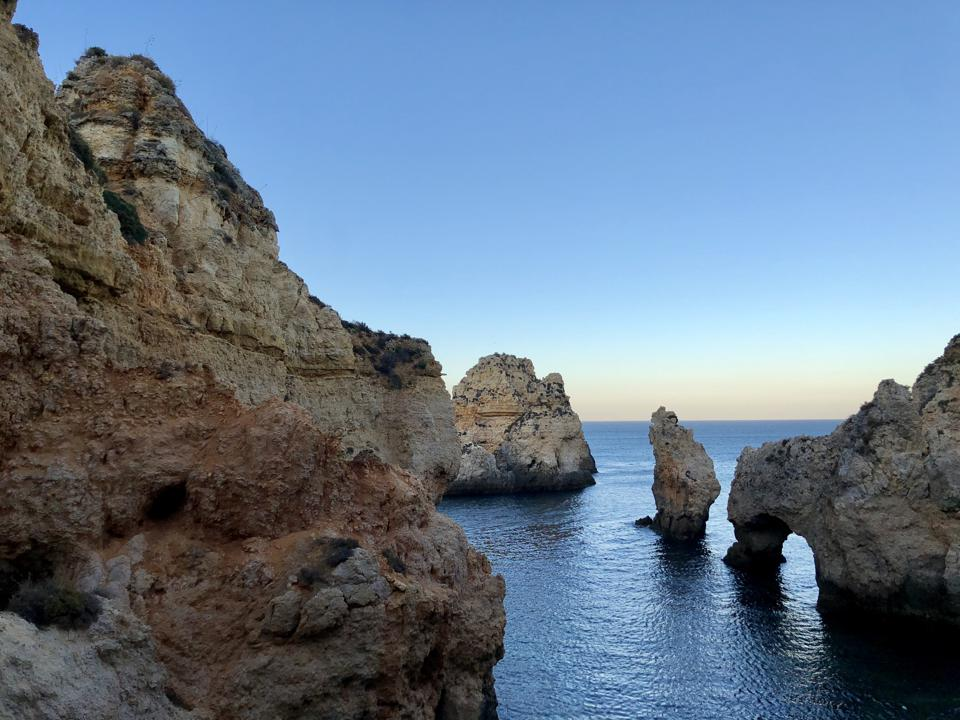The rock formations of Ponta da Piedade in the Algarve, Portugal, rise up from the sea