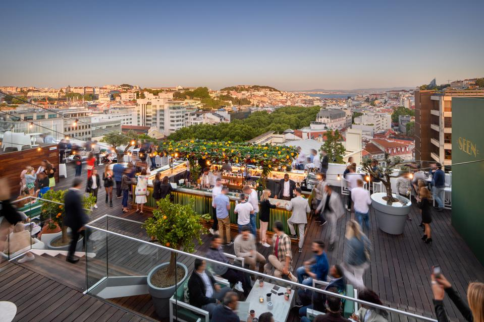 People are at the rooftop bar at Sky Bar by Seen at the Tivoli hotel in Lisbon, Portugal